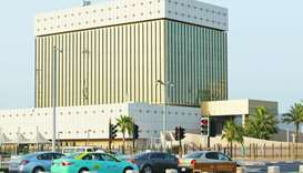Cars drive past the QCB building in Doha (file).