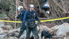 California mudslide rescuers expand search area for missing
