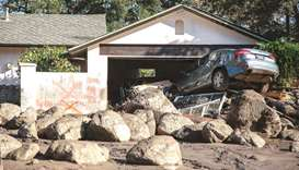 Rescuers at California mudslide expand search