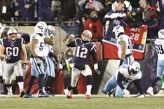 Patriots roll past Titans, Eagles clip Falcons
