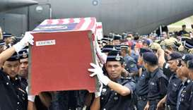 Royal Malaysian Police personnel carry a coffin of the late Inspector Zulkifli Mamat of the  69th Co