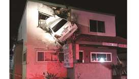 Airborne car crashes into second-floor office