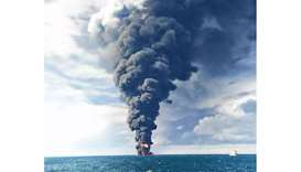 "Smoke and flames coming from the sinking oil tanker ""Sanchi"" at sea off the coast of eastern China."