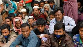 Rohingya refugees wait for food supply distribution at Balukhali camp, near Cox's Bazar, Bangladesh