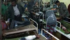 Rioters wounded in the police firing receive medical treatment at the Mrauk-U general hospital.