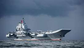 China's sole aircraft carrier, the Liaoning, arriving in Hong Kong waters