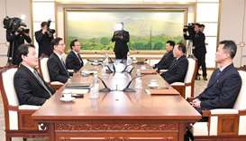 North Korean delegation members (R) talking with South Korean delegation members (L) during their wo