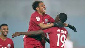 Qatar's Almoez Ali (right) and Hisham Ali celebrate during their team's quarter-final match against