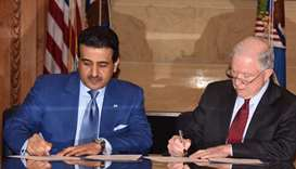 Qatar's Attorney General HE Dr Ali bin Fetais al-Marri and US Attorney General Jeff Sessions sign an