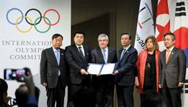 (From L) PyeongChang 2018 Olympics (POCOG) President Lee Hee-beom, North Korea's Sports Minister and