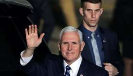 US Vice President Mike Pence waves upon their arrival at Ben Gurion international Airport in Lod, ne