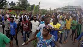 Demonstrators chant slogans during a protest against President Joseph Kabila, organized by the Catho