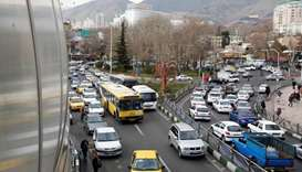 Iranians drive through Tajrish Square in the capital Tehran on January 2, 2018
