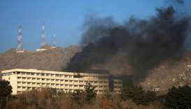 Smoke rises from the Intercontinental Hotel during an attack in Kabul, Afghanistan