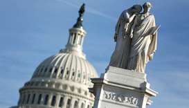 The figures of Grief and History stand on top of the Peace Statue near the U.S. Capitol after Presid