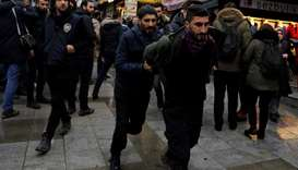 Riot police detain a demonstrator during a protest against Turkey's military operation in Syria's Af