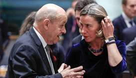 France's Foreign Minister Jean-Yves Le Drian (L) and European High Representative for Foreign Affair