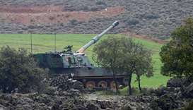 A Turkish army howitzer takes position on the Turkish-Syrian border in Hatay province, Turkey.
