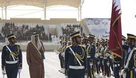 His Highness the Emir Sheikh Tamim bin Hamad al-Thani inspects a guard of honour.