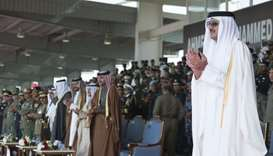 His Highness the Emir Sheikh Tamim bin Hamad al-Thani, accompanied by other dignitaries, attending t