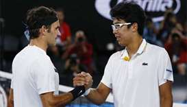 Dominant Federer into Australian Open final after Chung quits