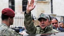 Turkey's Chief of the General Staff Hulusi Akar greets residents as he visits a neighborhood
