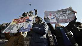 Supporters of Russian opposition leader Alexei Navalny attend a rally for a boycott of a March 18 pr