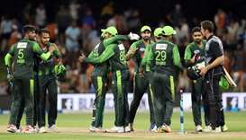 Pakistani players celebrate winning the third Twenty20 international cricket match between New Zeala