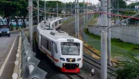 A train is seen along the newly built airport train line linking Soekarno-Hatta International Airpor