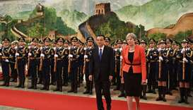 Britain's Prime Minister Theresa May (R) reviews a military honour guard with Chinese Premier Li Keq