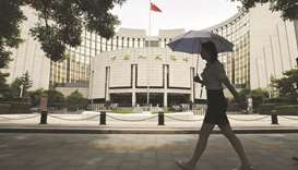 PBoC seen raising money market rates 3 times in '18