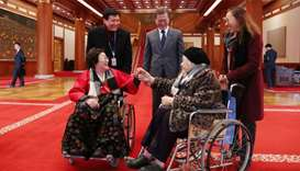 South Korean President Moon greets South Korean women who were forced to work in Japanese wartime br