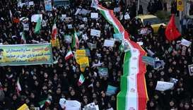 Iranian pro-government supporters march in the city of Najafabad