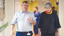 May apologises for cancelled surgeries