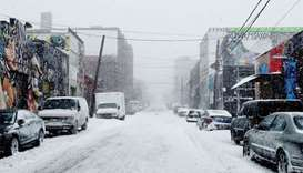 US Northeast digs out of blizzard as brutal cold bears down