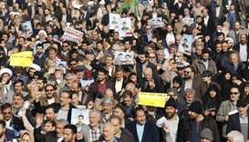 Iranian pro-government protesters take part in a march held after the weekly Friday prayers in centr
