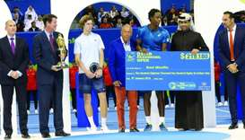 Monfils finally a champ in Qatar