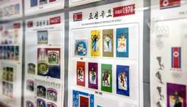 Stamps commemorating North Korea's participation in past winter Olympic Games is displayed at a stam