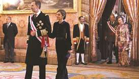 Spain's king pays homage to father Juan Carlos