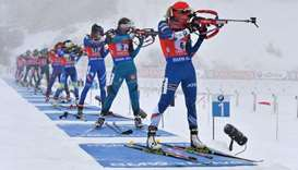 Athletes compete at the shooting range during the women's 4 x 6 km relay event of the IBU Biathlon W