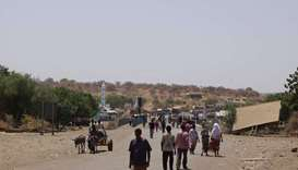 People crossing Sudan-Ethiopia border bridge
