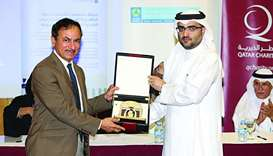 HMC's Development of Physicians director Dr Abdulatif Mohamed al-Khal receiving a memento