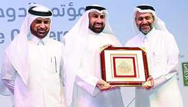 Al-Jaida with Dr Osama Qais al-Duraie, chief executive of Bait Al Mashura Finance Consultation, and