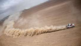 Toyota's driver Nasser Al-Attiyah of Qatar and French co-driver Mathieu Baumel compete in the Dakar