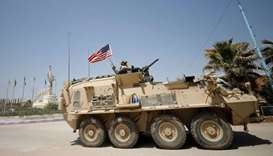 A US military vehicle travels in the town of Amuda
