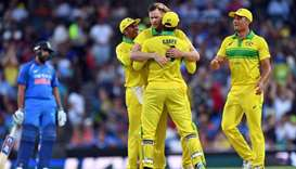 Australia's Jason Behrendorff (C) celebrates taking the wicket of India's Mahendra Singh Dhoni durin