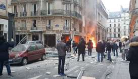 Fire burns at the site of an explosion at a bakery shop in Paris
