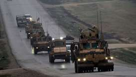 A convoy of US military vehicles rides in Syria's northern city of Manbij