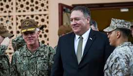 US Secretary of State Mike Pompeo (C) walks with Vice Admiral James Malloy (L),