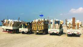 Trucks loaded with waste materials collected during the campaign